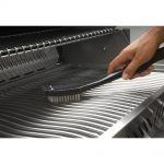 1000.62118_grill_brush_in_use_napoleon_grills